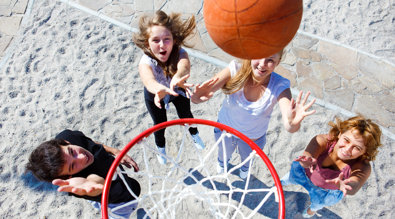 Young people playing basketball