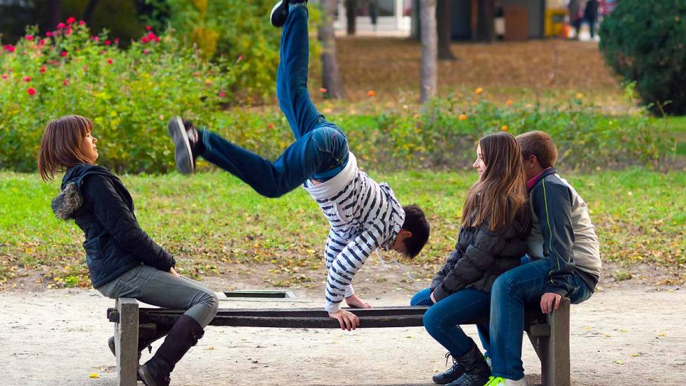Young people practising parkour in a park