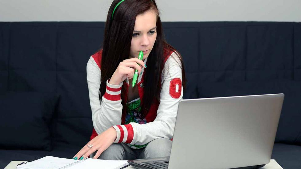 Young woman looking at a laptop