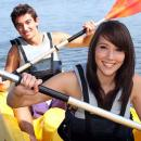 girl and boy kayaking
