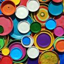 Brightly coloured painted tin lids
